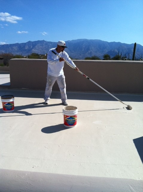 Man providing roof coating in Tucson, AZ